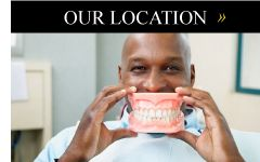 Our location | Man smiling with fake teeth